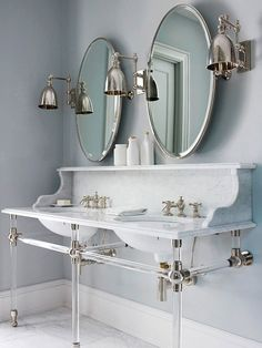 Things We Love: Console Sinks - Design Chic - great double console sink in the bathroom and love the round mirrors!