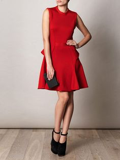 A great holiday look.  Givenchy dress, Alaia shoes, and Lanvin wood clutch