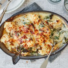 Creamy cauliflower cheese is one of those sides that always steals the show. We've added crispy kale and a gooey blend of cheddar, manchego and hard cheese for a heavenly bake that will transform your roast dinner. | Tesco