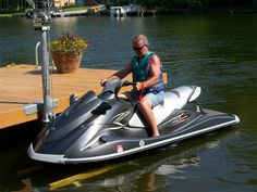 American Muscle Docks & Fabrication has re-designed the classic Mr. Lifter™ Jet Ski Lift to allow the lift to be used with the larger/heavier PWC on the water today Jet Ski Dock, Jet Ski Lift, Jet Ski Fishing, Fishing Boats, Boating Holidays, Boat Shed, Jet Skies, Boat Lift, Boat Dock