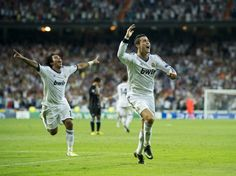 Cristiano Ronaldo (R) of Real Madrid celebrates scoring his sides winning goal during the UEFA Champions League group D match between Real Madrid and Manchester City FC at the Estadio Santiago Bernabeu on September 18, 2012 in Madrid, Spain
