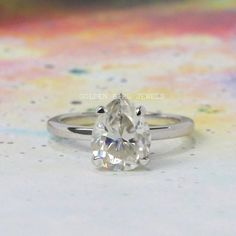 Pear Moissanite Solitaire Ring / 2.75 CT Colorless solitaire diamond engagement rings / White Gold Solitaire Ring / Anniversary Ring For Her  #Moissanite #MoissaniteRing #GBJ #DiamondGoldRing  #ProposalRing  #SimpleRing #SimpleEngagement #WeddingRing #EngagementRing #DiamondWeddingRing #DiamondEngagementRing#CustomizeRing #SilverDiamondRing  #Ring #SterlingSilverRing #AntiqueRing #StatementRing #WhiteGoldRing #SimpleRing #CustomRing#SolidGoldRing #MoissaniteWeddingRing… Moissanite Wedding Rings, Gold Solitaire Ring, Diamond Wedding Rings, Bridal Rings, Diamond Engagement Rings, Double Wedding Bands, Anniversary Rings For Her, Solid Gold Jewelry, Three Stone Rings