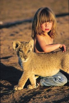 Tippi of Africa: Tippi Degré is a girl who was born in Namibia, and has a special bond with animals. Her parents, Alain Degré and Sylvie Robert, worked as freelance wildlife photographers in Namibia. During her stay in Namibia, she befriended wild animals, including a 28-year old elephant Abu, a leopard nicknamed J&B, crocodiles, lion cubs, giraffes, giant bullfrogs and chameleons - by Tippi Degré (1990), French/Namibian