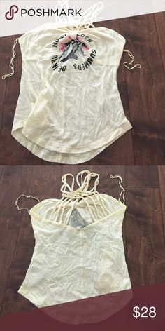 """Free People We The Free Strappy Tank NWOT Free People We The Free Strappy Tank NWOT new never worn. Size small. Tag is cut to prevent store return. Says """"hotel Eden dejavu summer"""" Free People Tops Tank Tops"""