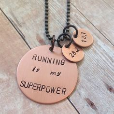 Running is my Superpower... Two Distance Version This is a handstamped copper pendant with two copper charms on hand-oxidized copper ball chain. This piece features a handstamped message in mixed lowe