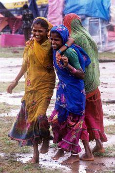 Beautiful girls having fun in the mud......made by the elephant...ha, ha, ha....