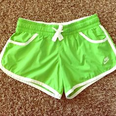 NIKE shorts Super cute and super soft! Just wore them once! Light green and white! Nike Shorts