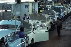 """""""ICYMI Life in the Trabant assembly line, VEB Sachsenring, Zwickau. Photo: Bundesregierung B 145 East German Car, German Reunification, National Airlines, East Germany, Small Cars, Cars And Motorcycles, Vehicles, Work Hard, Vw"""