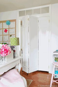 Step-by-step photo tutorial showing how to transform $5 thrift store doors with wheels and paint to make one of a kind rolling doors for a doorway | In My Own Style