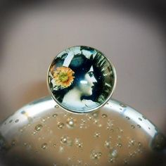 Fleur Dame Ring - Large, silver plated, solid glass, dome- fronted, ring, with vintage digital collage of a lady with a large sunflower in her hair. Green and yellow predominantly. Size of front - 3cm x 3cm. Ring - adjustable to fit. Comes gift wrapped. - £10.99
