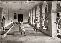 """""""Blind children playing hide-and-seek among arcade pillars"""" at the Overbrook School in Philadelphia ca. 1912. Geo. Grantham Bain Collection."""