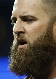 Boston Red Sox's Mike Napoli looks down after the fifth inning during Game 5 of the American League baseball championship series against the...
