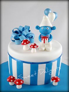 Smurf Cake...I LOVE LOVE LOVE this, but would like a Smurfette cake!!