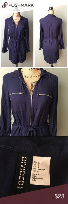 """H&M Divided size 4 navy blue shirt dress! H&M Divided size 4 navy blue shirt dress! Great gently worn condition. Has matching tie belt. Zipper details. Dress is unlined. Approximate flat measurements: bust 16.5"""", waist 16.5"""", hips 19"""", length 31.5"""". I don't trade. Reasonable offers welcome. Thanks! 😊 H&M Dresses"""