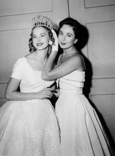 Charlotte Sheffield, Miss USA 1957, of Utah, is crowned by Carol Morris, Miss Universe 1956. Sheffield took the crown when the original winner, Leona Gage of Maryland, was quickly disqualified. Turned out, Gage, 18, was not only married but had two children, thus breaking two rules at once.  Mi abuela.