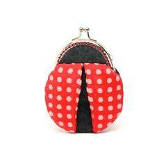 Magical ladybug mini coin purse. $24.90, via Etsy.