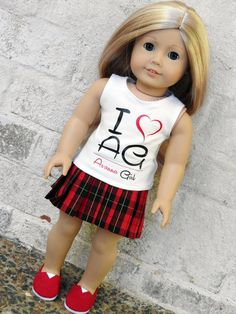 I Love AG Avanna Girl Graphic Tank Top for American Girl Doll  Love your AG Doll? Then this is a must have graphic tank top by Avanna Girl! Graphic made with a heat transfer vinyl made by my son at www.memphisshirt.com. Tank top is made with a super soft organic interlock knit. Closes in back with with a low snag, ultra thin velcro. Tee Shirt pattern by Liberty Jane.  All items made by me in my smoke free studio. I am not affiliated with American Girl or Mattel.  Please allow 5-7 days for…