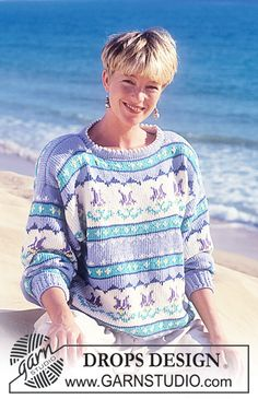 "DROPS 25-6 - DROPS jumper with landscape and flower pattern in ""Paris"". - Free pattern by DROPS Design"