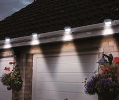 Solar-Powered LED Outdoor Lights - Fastens onto Your Rain Gutters - 2 Pack or 4 Pack. The Solar White Garden Gutter Light is a revolutionary multi-use solar product that attaches to Gutters, Signs, Fences, and to any flat surface. Exterior Lighting, Outdoor Lighting, Outdoor Decor, Lighting Ideas, Outdoor Spaces, Fence Lighting, Light Clips, My Pool, Solar Lights