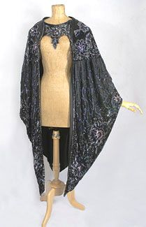 1918 black tulle and satin evening cape decorated with elaborate beading, sequins and embroidery.