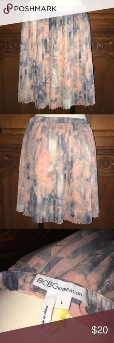 NWOT BCBGeneration Pleated Skirt Elastic Waist NWOT BCBGeneration Pleated Skirt Elastic Waist. Size Large. Material is 100% polyester. Has a peach colored lining. I have never worn this skirt and its in like new condition. The pattern is peach and blue with gorgeous pleats! BCBGeneration Skirts