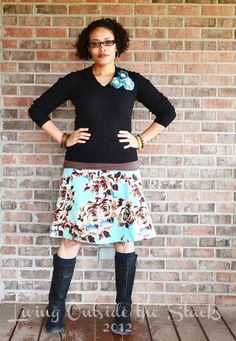 Black sweater, brown cami, floral skirt, and black boots {Living Outside the Stacks}