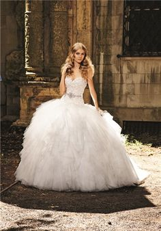 Dress Details  TULLE LAYERED, BALLGOWN WITH STRAPLESS SHEER BODICE Silhouette: Ball Gown Neckline: Strapless Gown Length: Floor Fabric: Tulle Color: Ivory Size: 4 - 24 Matching Elements: Matching Veil