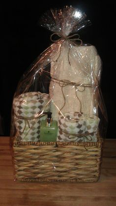 Gift Basket for a first time home buyer...this basket includes a bath towel, hand towel, wash cloth, large & medium bathroom carpets & hand soap.