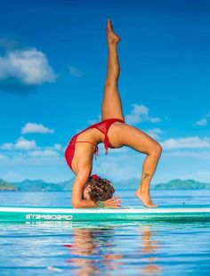 I will learn how to do this one day! SUP Yoga headstand variations.