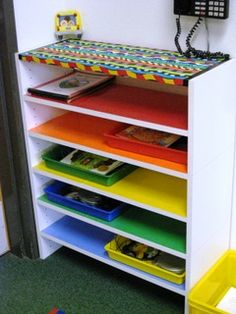 Color code shelves so kids know the correct place for Word Work tubs and/or math tubs. Use laminated construction paper taped to shelves or use colored contact paper. Classroom Organisation, Teacher Organization, Classroom Setup, Classroom Design, Teacher Tools, Kindergarten Classroom, School Classroom, Classroom Decor, Classroom Management