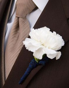 white carnation with blue ribbon for groomsmen and parents