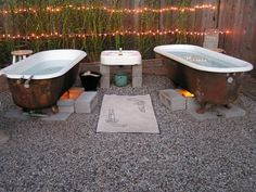 This is what a friend of Greg's did with their backyard. Love it, the fire below the tub, heats up the water.