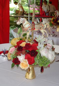 red white and gold carousel horse, A carousel theme party in July