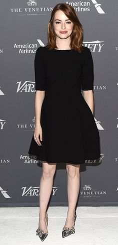 EMMA STONE wearing the perfect LBD, courtesy of Dolce & Gabbana and bow-accented Christian Louboutin heels.