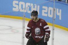 DAY 9:  Lauris Darzins of Latvia competes during the Ice Hockey Men's Preliminary Round Group C - Latvia vs. Sweden http://sports.yahoo.com/olympics