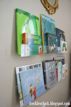 http://cleardisplays.com/Clear-Acrylic-Card-Strip-for-Wall.html; from http://freckleschick.blogspot.com/search/label/nursery%20diaries#