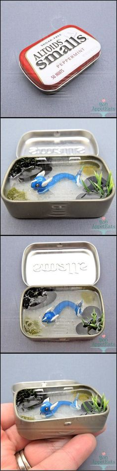 The finished dragonair tin commission inside a small Altoids tin.  Dragonair was sculpted from polymer clay. The water is clear resin.  I still have some Altoids tins available for more tin pond commissions. :) Just use the Contact Us link on the sidebar