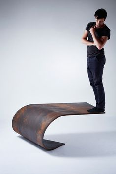 We've ended our search for the perfect table: UK-based designer Paul Cocksedge's Poised Table creation, which is crafted from a single sheet of rolled steel, is sturdy enough to balance a regular bloke on the edge. It's full of win.