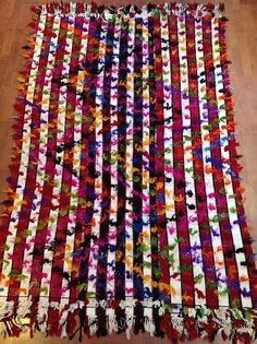 We've just started to see these pop up… I think they share an interesting story and bohemian chic look similar to the bright nomadic Moroccan rugs we see everywhere now.  |  The warp and weft are cotton and wool, and woven on small looms then hand-stitched together; note the black or red stripe.  |  Then like most Tulu rugs soft hand-spun mohair is tied off - in this case it is brightly dyed fuchsia, yellow... Kurdish, Cihanbeli, Turkey. Age ~30-40 yrs. #TU040 Size: 54x92 $995. too low!!