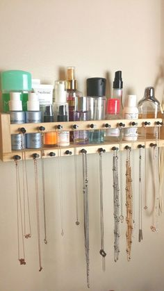 Ikea spice rack hack - hubby just put this up for me.  I used thumb tacks to hang my necklace collection.  Keep in mind, I had trouble pushing/hammering all thumb tacks all the way in, so unless you can do that, this is only ideal for very lightweight pieces.