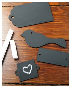 Gift ties....little wood shapes painted with chalkboard paint.  Great idea!