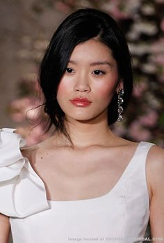 A fresh, romantic look with cherry stained lips and soft pink cheeks gives the perfect glow for an outdoor wedding.