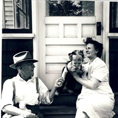 Gramma and Grampa Ben and Betsy  I love this picture. It gives me a tactile connection to my maternal grandparents. This was in front of their home on Chesnut Street, across the street from the railroad tracks. Mom said during the Great Depression, there was rarely a supper without someone coming to the back door to ask for food. There was always a plate for them. Carl, my grandfather was President of a bank. One of my cousins told me recently that a portrait of him still hangs in he bank…