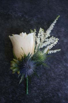 wedding bouquet with holly leaves white roses and sea holly - Google Search