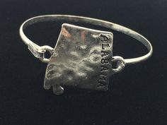 Burnished silver tone state Alabama bracelet with hook closure.