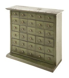 Pennsylvania painted poplar seed chest, late 19th c., with thirty small drawers and retaining an old green surface, 20'' h., 21'' w.