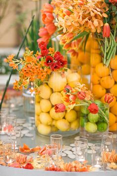 Love this vibrant display of yellow, orange and green. Love the organic look of fruit in glass containers.