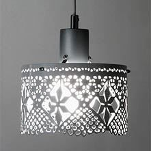 Gladys, with a beautiful lace pattern and made in stainless or white lacquered steel, is available in two sizes. Stylish, modern and and at the same time very traditional - a beautiful lamp with attitude!