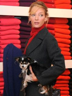 Uma Thurman takes her pup shopping in New York on 16 October, 2009.