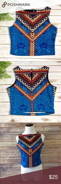 "Bisou Bisou Aztec Pattern Crop Top Very cute structured crop top. Features a cute button back closure. Fully lined and very stretchy. Bust: 36""-42"" Length: 17"" Shell: 95% polyester, 5% spandex Lining: 100% polyester Bisou Bisou Tops Crop Tops"